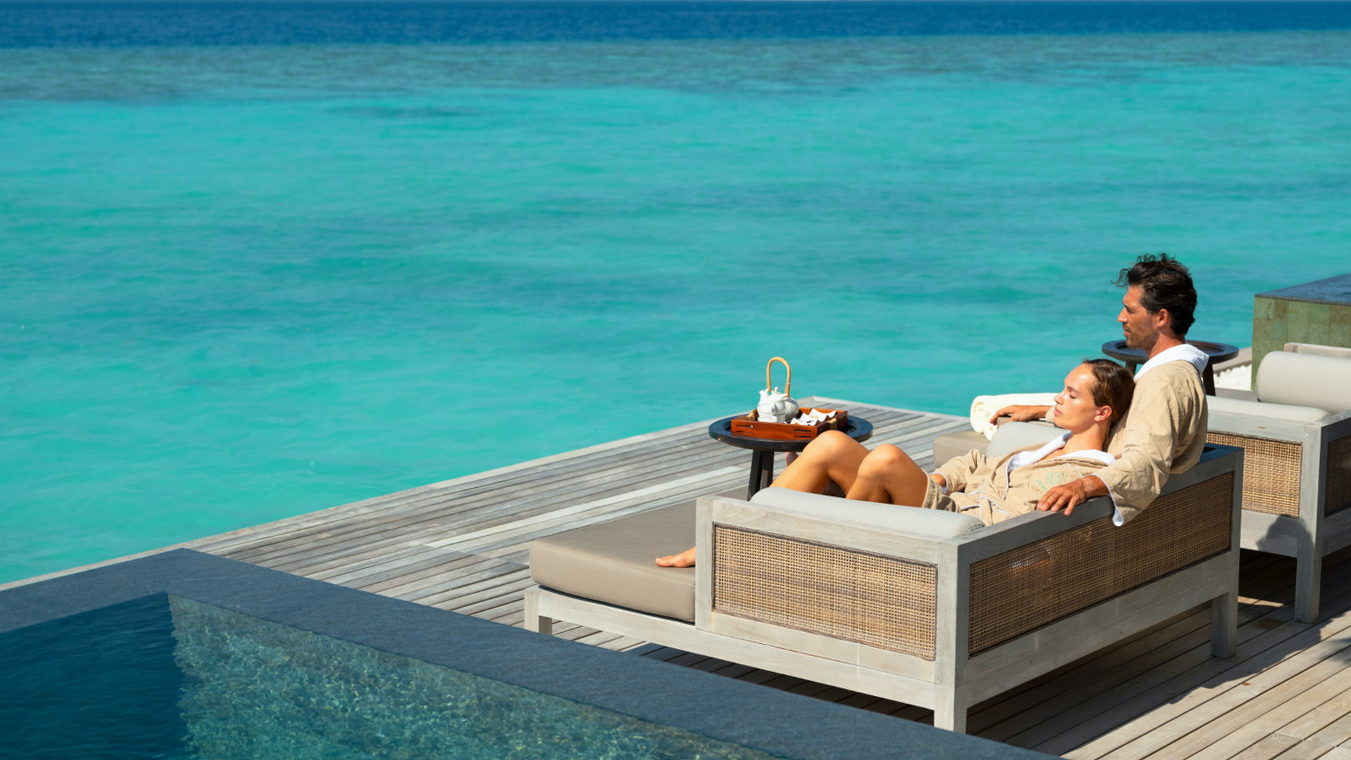 Vakkru Maldives  - Couple relaxing in a Over water terrace