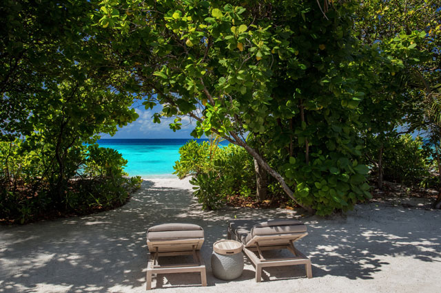 Vakkaru Maldives Beach Villa sunbeds overlooking the ocean