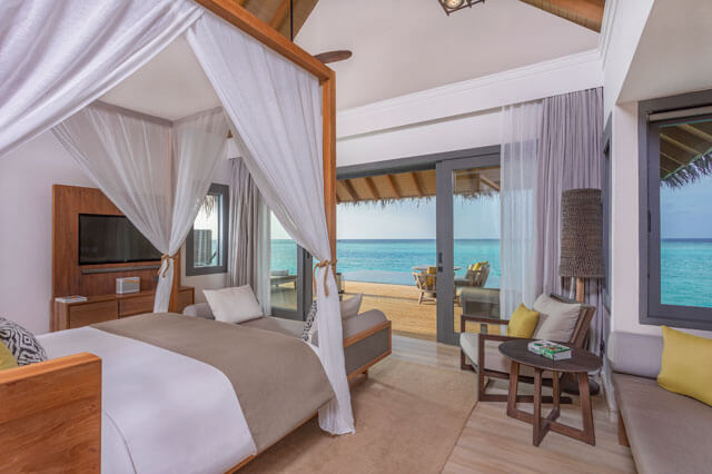 Vakkaru Maldives Over Water Family Pool Villa Bedroom with Ocean View